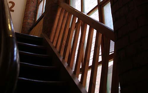 Photo of Manchester Buddhist Centre wooden stairwell