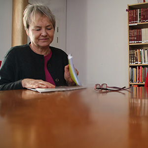 Woman studying in Manchester Buddhist Centre library