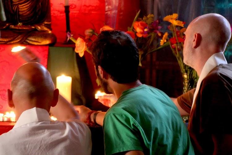 Men at shrine at festival puja
