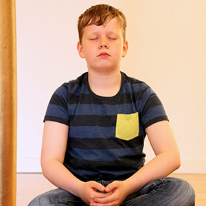 child meditating during school visit
